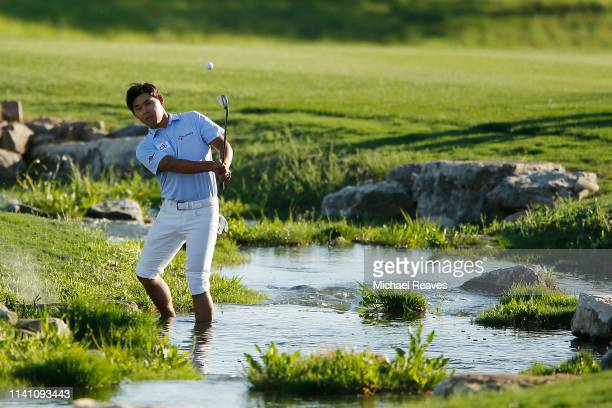Si Woo Kim of Korea plays a shot on the 18th hole during the final round of the 2019 Valero Texas Open at TPC San Antonio Oaks Course on April 07,...