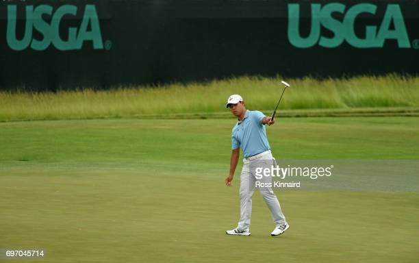 Si Woo Kim of Korea reacts after a putt on the 18th green during the third round of the 2017 US Open at Erin Hills on June 17 2017 in Hartford...