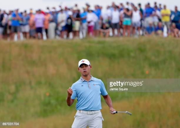 Si Woo Kim of Korea reacts after making a birdie the 13th green during the third round of the 2017 US Open at Erin Hills on June 17 2017 in Hartford...