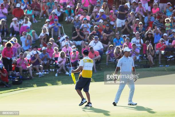 Si Woo Kim of South Korea celebrates after finishing on the 18th green during the final round of THE PLAYERS Championship at the Stadium course at...