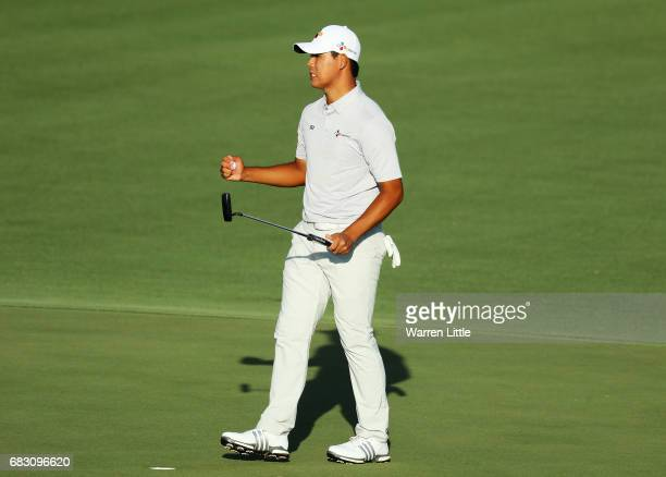 Si Woo Kim of South Korea celebrates on the 18th green after finishing 10 under to win during the final round of THE PLAYERS Championship at the...