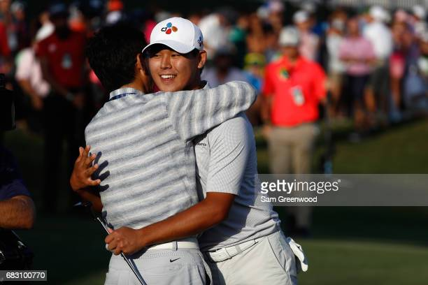 Si Woo Kim of South Korea celebrates with his father on the 18th green after finishing 10 under to win during the final round of THE PLAYERS...
