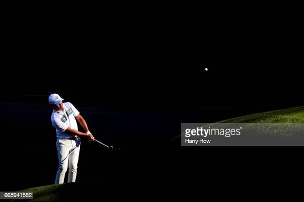 Si Woo Kim of South Korea chips to the 13th green during the second round of the 2017 Masters Tournament at Augusta National Golf Club on April 7,...