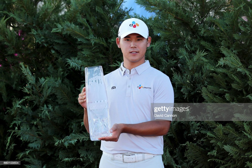 Si Woo Kim of South Korea holds the trophy after his win in the final round of the THE PLAYERS Championship on the Stadium Course at TPC Sawgrass on May 14, 2017 in Ponte Vedra Beach, Florida.
