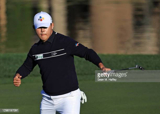 Si Woo Kim of South Korea makes a birdie putt on the 17th hole during the final round of The American Express tournament on the Stadium course at PGA...