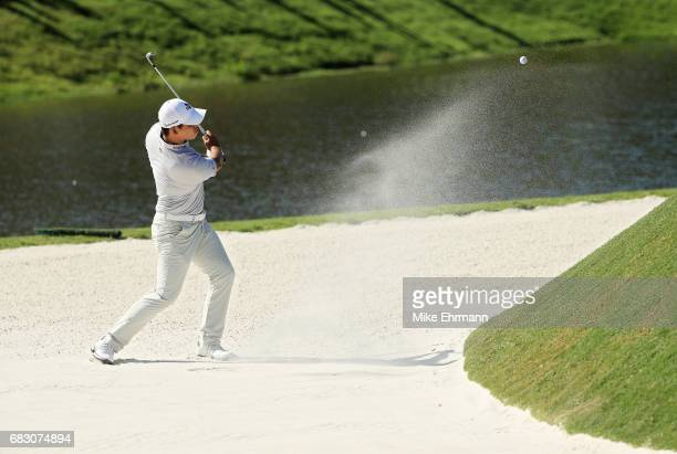Si Woo Kim of South Korea plays a shot from a bunker on the 11th hole during the final round of THE PLAYERS Championship at the Stadium course at TPC...