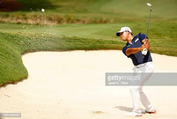 Si Woo Kim of South Korea plays a shot from a greenside bunker on the 18th hole, the second-playoff hole in a six-way sudden-death playoff, during...