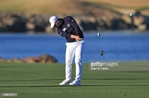 Si Woo Kim of South Korea plays a shot on the 18th hole during the final round of The American Express tournament on the Stadium course at PGA West...