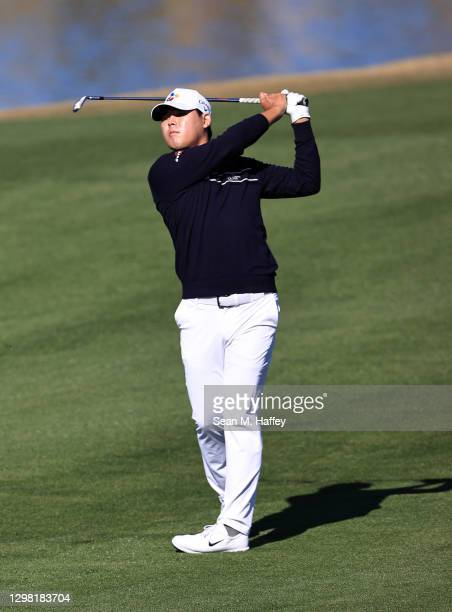 Si Woo Kim of South Korea plays a shot on the ninth hole during the final round of The American Express tournament on the Stadium course at PGA West...