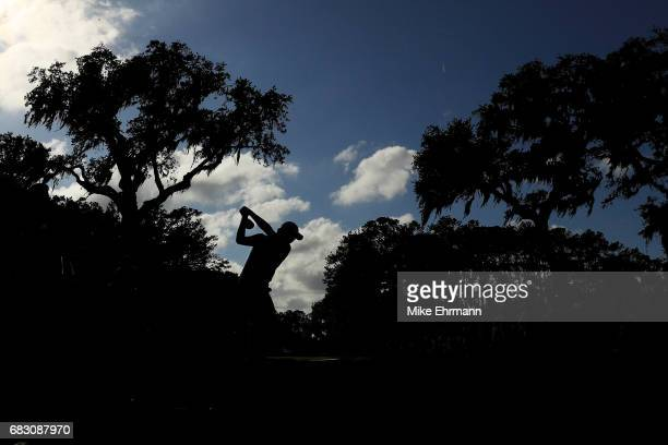 Si Woo Kim of South Korea plays his shot from the 15th tee during the final round of THE PLAYERS Championship at the Stadium course at TPC Sawgrass...