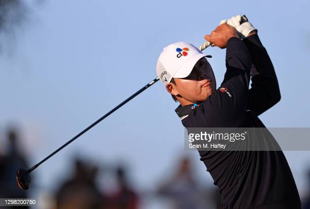 Si Woo Kim of South Korea plays his shot from the 18th tee during the final round of The American Express tournament on the Stadium course at PGA...