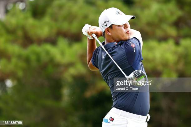 Si Woo Kim of South Korea plays his shot from the 18th tee during the final round of the Wyndham Championship at Sedgefield Country Club on August...