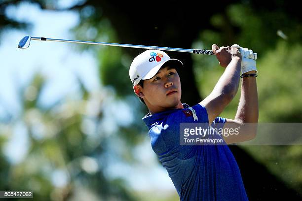 Si Woo Kim of South Korea plays his shot from the fourth tee during the final round of the Sony Open In Hawaii at Waialae Country Club on January 17...