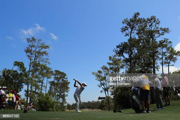 Si Woo Kim of South Korea plays his shot from the fourth tee during the final round of THE PLAYERS Championship at the Stadium course at TPC Sawgrass...