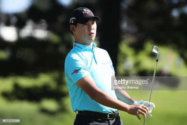 Si Woo Kim of South Korea plays his shot from the second tee during the first round of the Sentry Tournament of Champions at Plantation Course at...