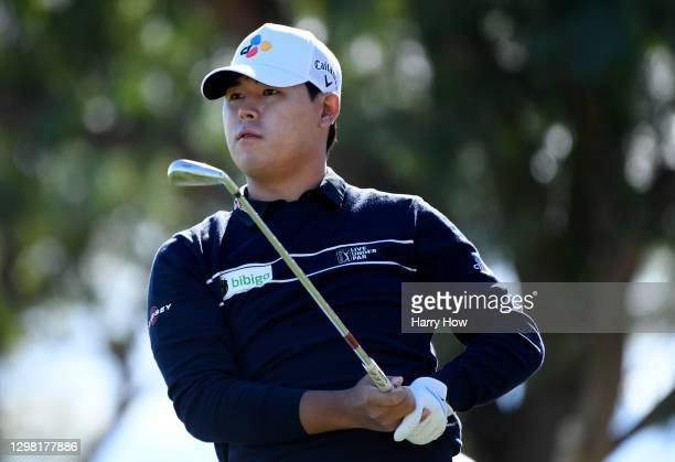 Si Woo Kim of South Korea plays his shot from the sixth tee during the final round of The American Express tournament on the Stadium course at PGA...