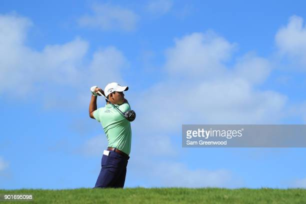 Si Woo Kim of South Korea plays his shot from the tenth tee during the second round of the Sentry Tournament of Champions at Plantation Course at...