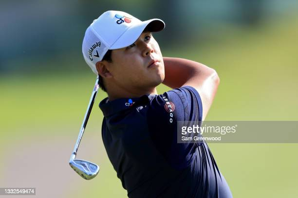 Si Woo Kim of South Korea plays his shot on the first hole during the first round of the FedEx St. Jude Invitational at TPC Southwind on August 05,...