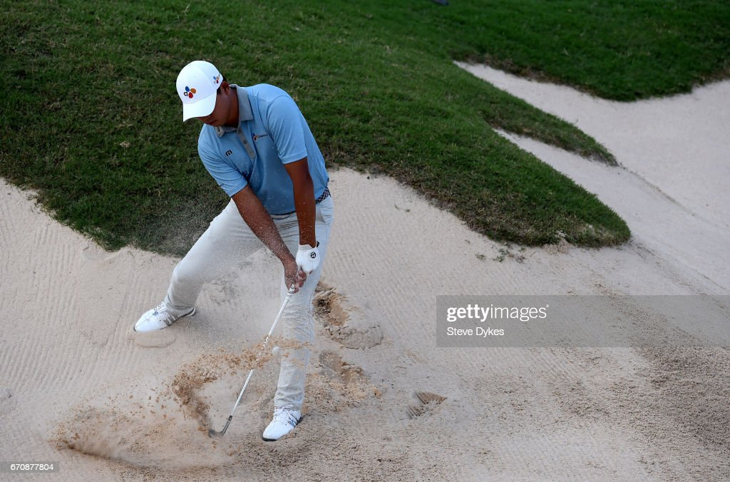 Si Woo Kim of South Korea plays his shot out of the bunker on the 15th hole during the first round of the Valero Texas Open at TPC San Antonio AT&T Oaks Course on April 20, 2017 in San Antonio, Texas.