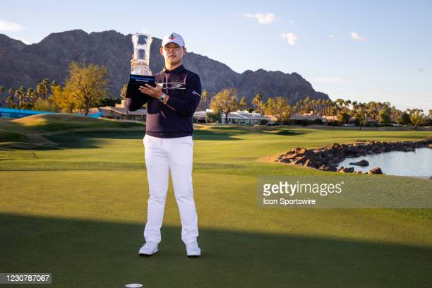Si Woo Kim of South Korea poses with the trophy after the final round of The American Express PGA Tournament on January 24, 2021 at PGA West Pete Dye...