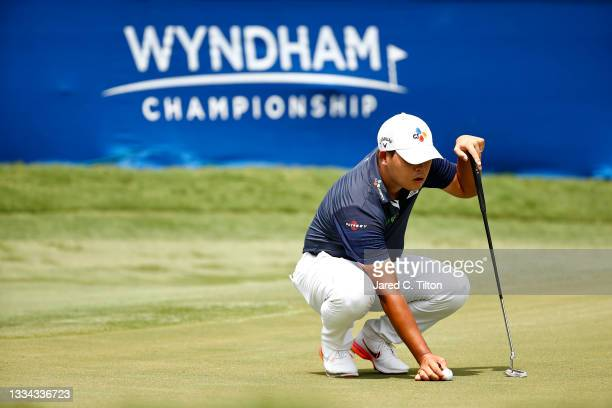 Si Woo Kim of South Korea prepares to putt on the 18th green during the final round of the Wyndham Championship at Sedgefield Country Club on August...