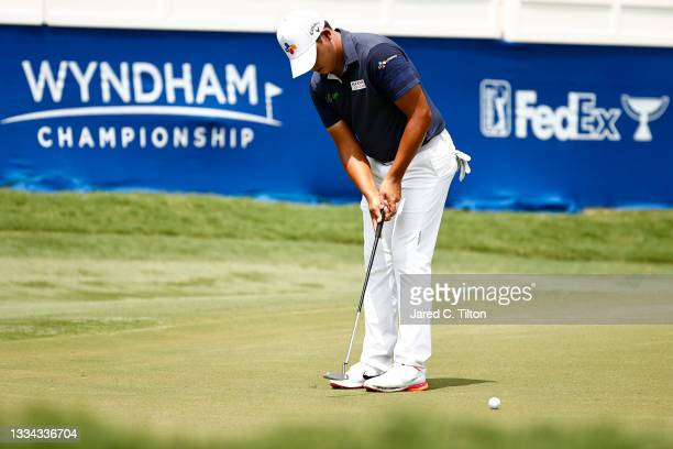 Si Woo Kim of South Korea putts on the 18th green during the final round of the Wyndham Championship at Sedgefield Country Club on August 15, 2021 in...