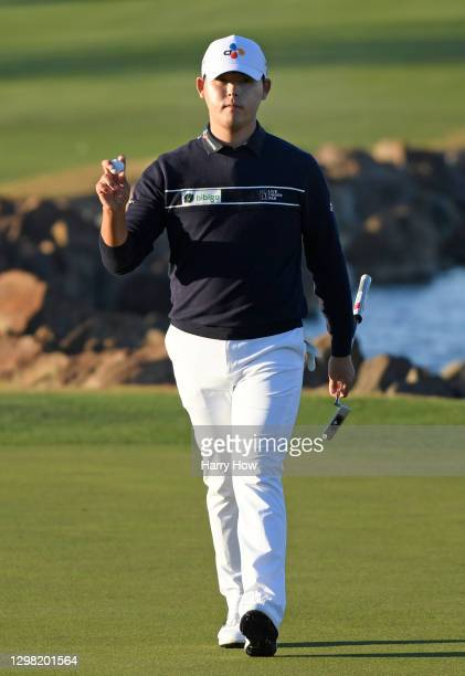 Si Woo Kim of South Korea reacts after putting in to win on the 18th green during the final round of The American Express tournament on the Stadium...