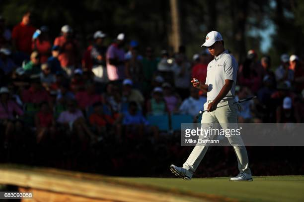 Si Woo Kim of South Korea reacts on the 17th green during the final round of THE PLAYERS Championship at the Stadium course at TPC Sawgrass on May 14...
