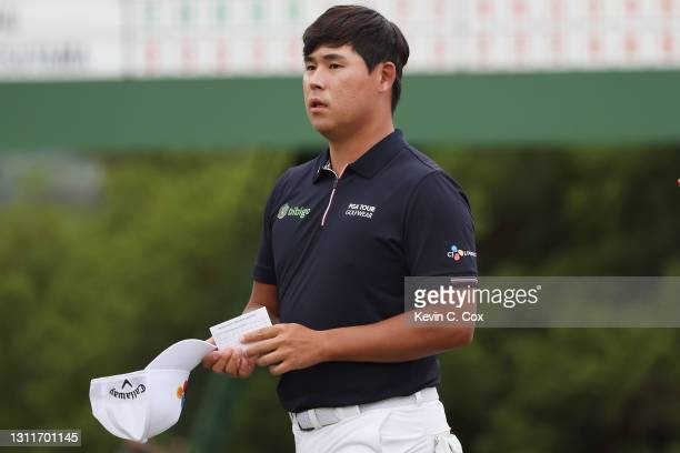 Si Woo Kim of South Korea reacts on the 18th green during the second round of the Masters at Augusta National Golf Club on April 09, 2021 in Augusta,...