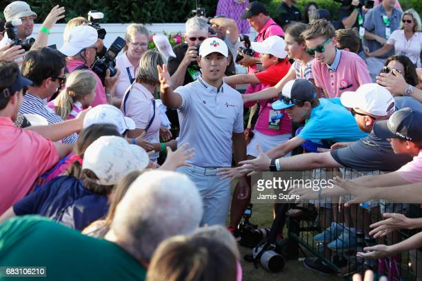 Si Woo Kim of South Korea throws his glove to fans after winning during the final round of THE PLAYERS Championship at the Stadium course at TPC...