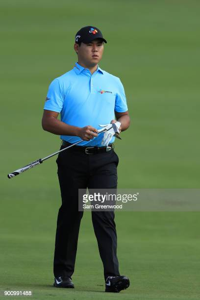 Si Woo Kim of South Korea walks during the proam tournament prior to the Sentry Tournament of Champions at Plantation Course at Kapalua Golf Club on...