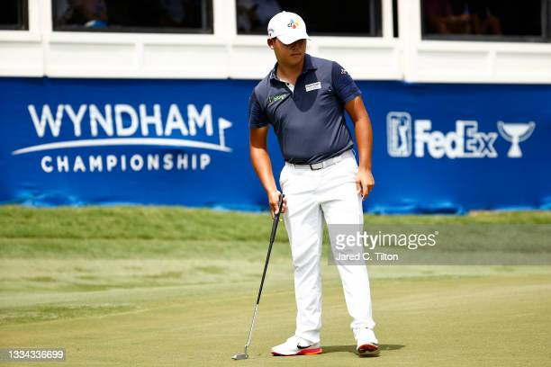 Si Woo Kim of South Korea watches his putt on the 18th green during the final round of the Wyndham Championship at Sedgefield Country Club on August...