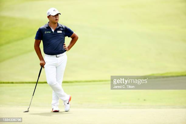 Si Woo Kim of South Korea waves on the 17th green during the final round of the Wyndham Championship at Sedgefield Country Club on August 15, 2021 in...