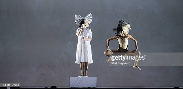 Sia and Maddie Ziegler perform on stage during the opening night of her Nostalgic for the Present tour at KeyArena on September 29 2016 in Seattle...