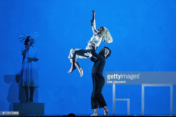 """Sia and Maddie Ziegler perform on stage during the opening night of her """"Nostalgic for the Present"""" tour at KeyArena on September 29, 2016 in..."""