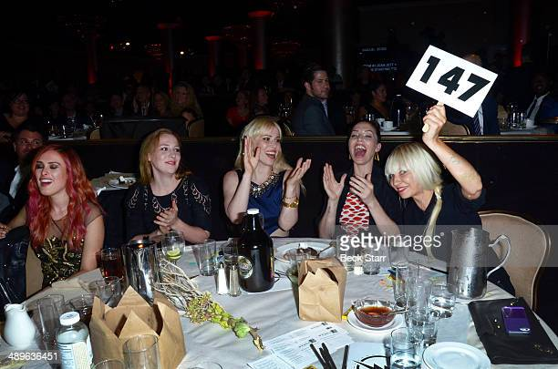 Sia bids at The LA Gay Lesbian Center's Annual An Evening With Women at The Beverly Hilton Hotel on May 10 2014 in Beverly Hills California