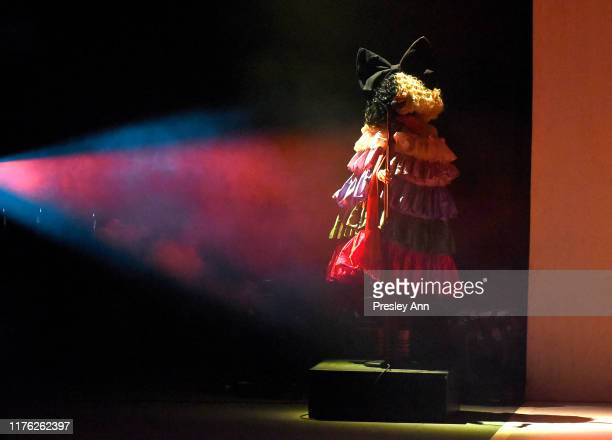 Sia performs onstage Los Angeles LGBT Center Celebrates 50th Anniversary With Hearts Of Gold Concert Multimedia Extravaganza at The Greek Theatre on...
