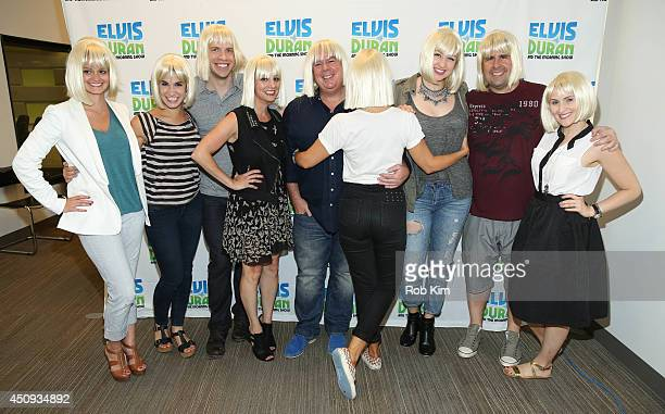 Sia poses with The Elvis Duran Z100 Morning Show team at Z100 Studio on June 17 2014 in New York City