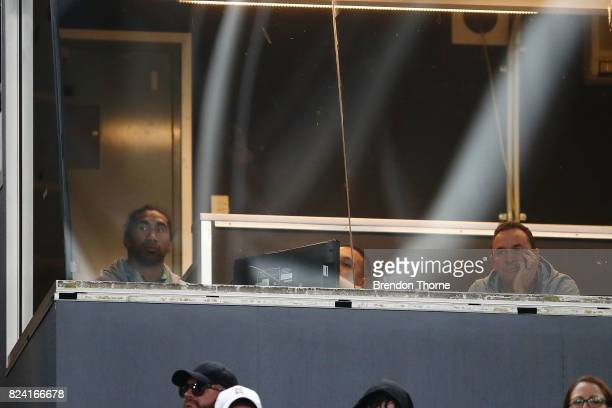 Sia Soliola and Ricky Stuart of the Raiders look on from the coaches box during the round 21 NRL match between the South Sydney Rabbitohs and the...