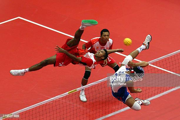 Siaful Rijal of Indonesia kicks over the net against John Thao of USA during the Round Robin match between Indonesia and USA day two of the ISTAF...