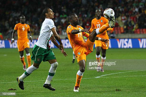 Siaka Tiene of Ivory Coast tries to control the ball as he is closed down by Liedson of Portugal during the 2010 FIFA World Cup South Africa Group G...