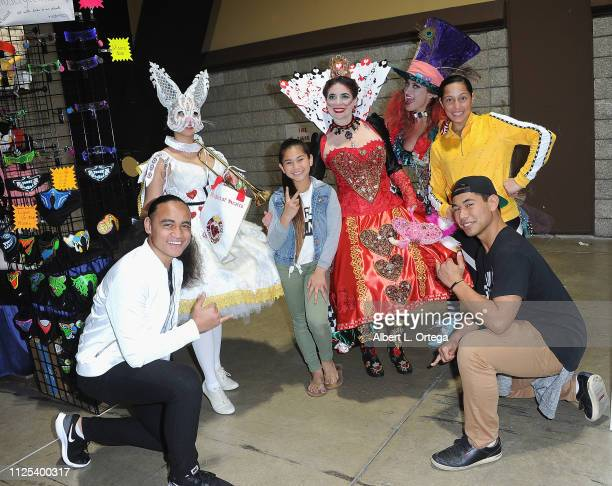 Siaki Sii Tava'e Scanlan LLove'a Brittingham and Epati Scanlan pose with characters from 'Alice In Wondrland' at the 2019 Long Beach Comic Expo held...