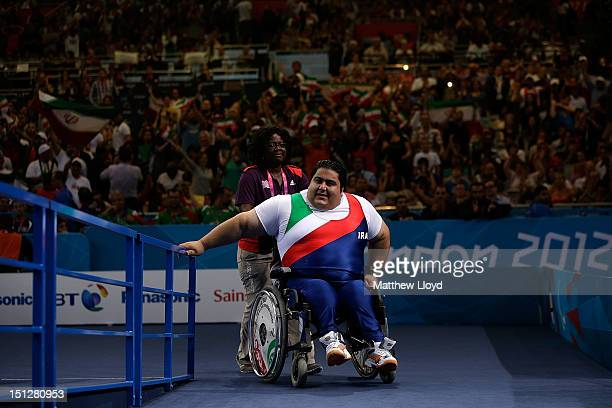 Siamand Rahman of the Islamic Republic of Iran leaves the stage after making his final lift during the Men's 100 kg Powerlifting on day 7 of the...
