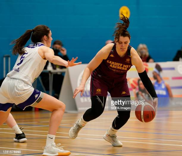 Sian Phillips and Cristina Bigica are seen in action during the Women's British Basketball League match between WBBL Cardiff Archers and Caledonia...