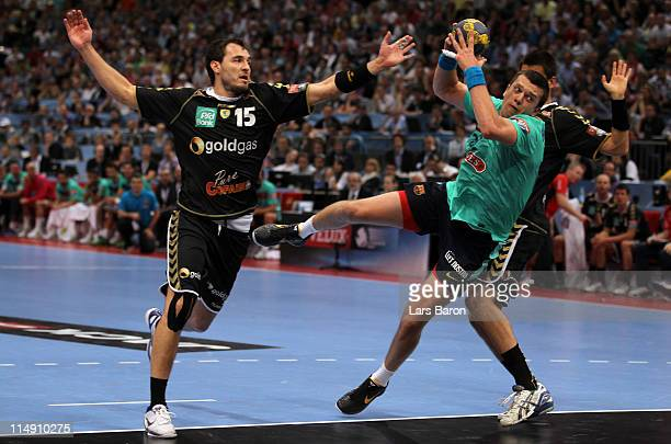 Siarhei Rutenka of Barcelona is challenged by Michael Mueller and Zarko Sesum of Rhein Neckar during the EHF Final Four semi final match between...