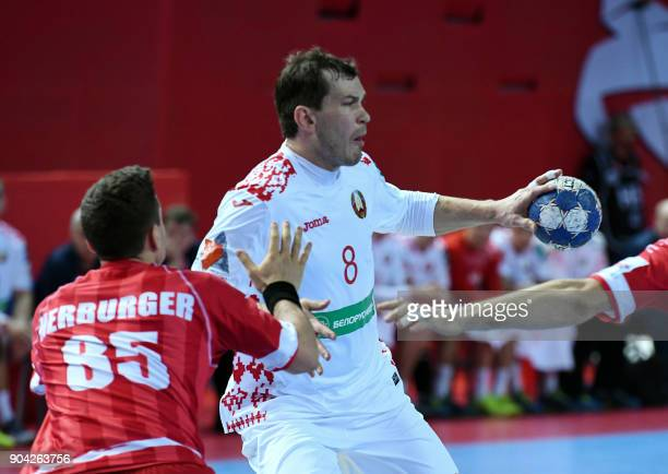 Siarhei Shylovich of Belarus fights for the ball with Lukas Herbrurger of Austria during the preliminary round group B match of the Men's 2018 EHF...