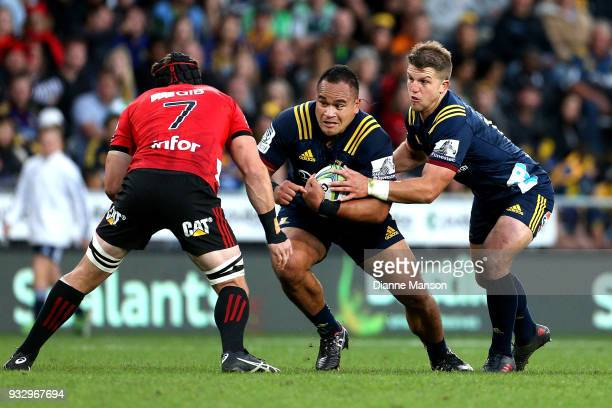 Siate Tokolahi of the Highlanders is challenged by Matt Todd of the Crusaders during the round five Super Rugby match between the Highlanders and the...