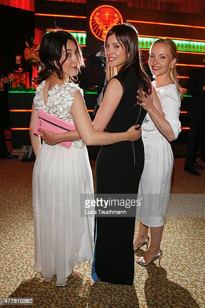 Sibel Kekilli Aylin Tezel and Janin Reinhardt attend the German Film Award 2015 Lola party at Palais am Funkturm on June 19 2015 in Berlin Germany