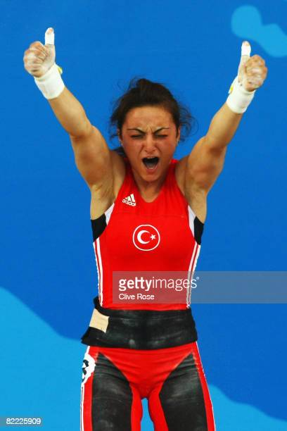Sibel Ozkan of Turkey celebrates a lift in the Women's 48kg Group A Weightlifting event held at the Beijing University of Aeronautics and...