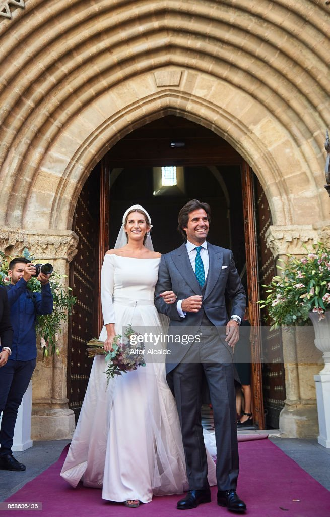 Sibi Montes (L) and Alvaro Sanchis (R) looks on during their wedding at Parroquia Santa Ana on October 7, 2017 in Seville, Spain.